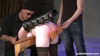 Spanked and abused brunette teen slave in a BDSM fetish scene