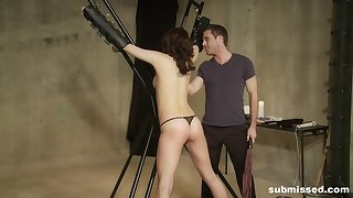 Brunette babe Sadie Holmes strapped in and abused and spanked hard